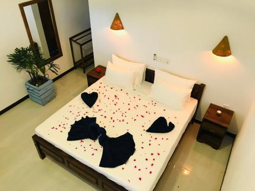 Ein Bett oder Betten in einem Zimmer der Unterkunft Oasis Bay