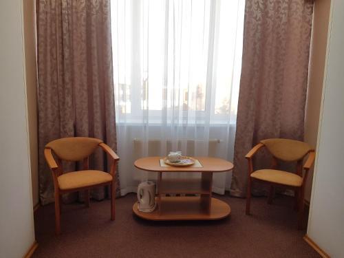 Гостиная зона в Август Отель
