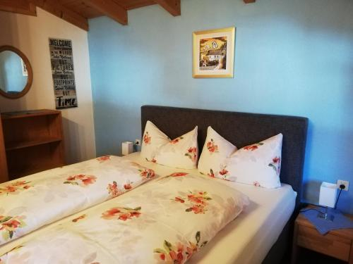 Ein Bett oder Betten in einem Zimmer der Unterkunft FEWO Piccolo