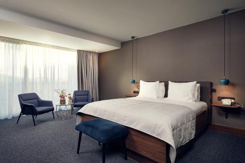 A bed or beds in a room at Van der Valk Hotel Eindhoven