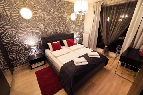 Łóżko lub łóżka w pokoju w obiekcie Nights Apartments