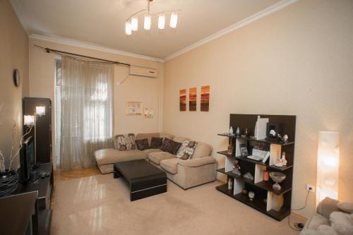 Uma área de estar em Luxhome