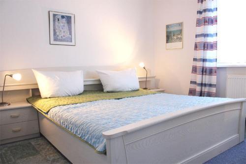 Ein Bett oder Betten in einem Zimmer der Unterkunft Appartementhaus Olymp