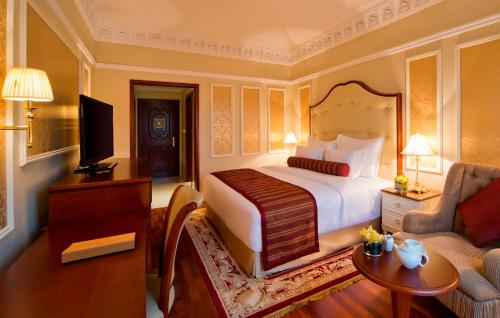 A bed or beds in a room at Warwick Doha