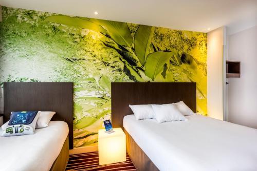Un ou plusieurs lits dans un hébergement de l'établissement ibis Styles Saint Julien en Genevois Vitam