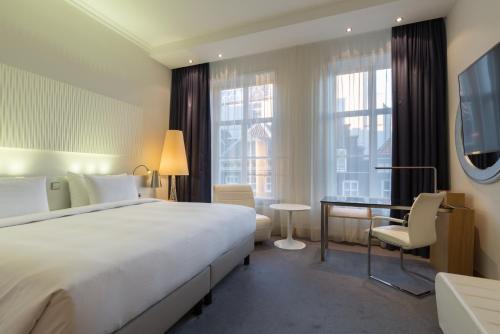 Un ou plusieurs lits dans un hébergement de l'établissement Radisson Blu Hotel, Amsterdam City Center