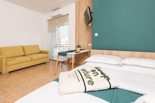 A bed or beds in a room at Pantheon Square View Komotini