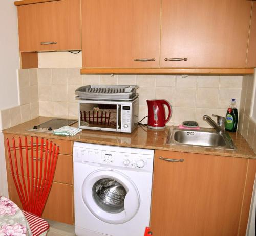 A kitchen or kitchenette at Apartments on the Beach