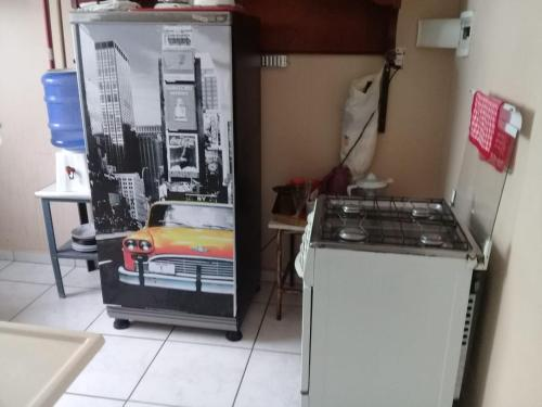 A kitchen or kitchenette at Seu Apartamento em Itaúna