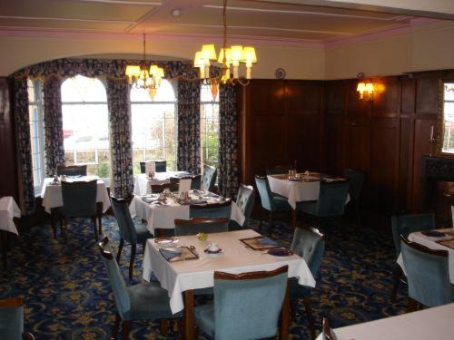 A restaurant or other place to eat at St. Winifreds Hotel