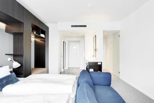 En eller flere senge i et værelse på Comwell Kellers Park