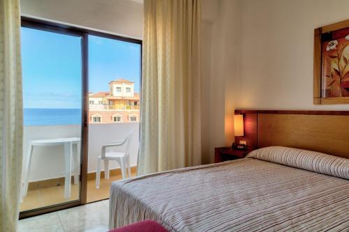 Cama o camas de una habitación en Hotel Marquesa