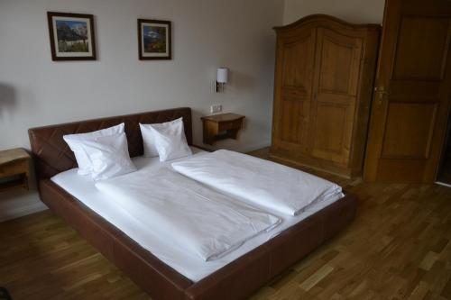 Ein Bett oder Betten in einem Zimmer der Unterkunft Hotel Terofal