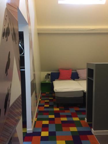 Een bed of bedden in een kamer bij FunKey Hotel