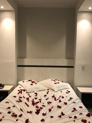 Cama ou camas em um quarto em Scarpelli Palace Hotel