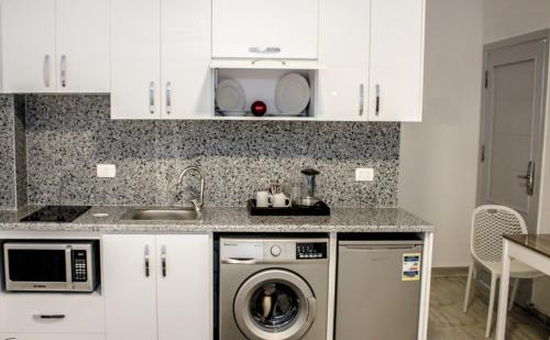 Aqua Palms Resort (Apartments and Villas)にあるキッチンまたは簡易キッチン