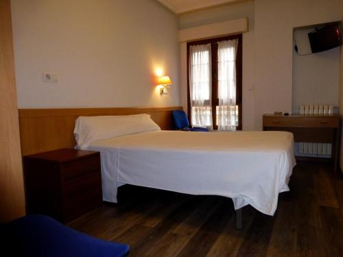 Cama o camas de una habitación en Pensión Romero