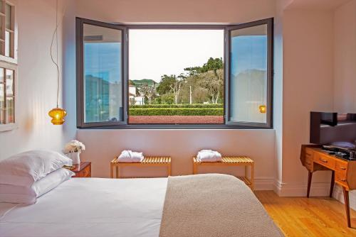 A bed or beds in a room at Herdade do Ananás