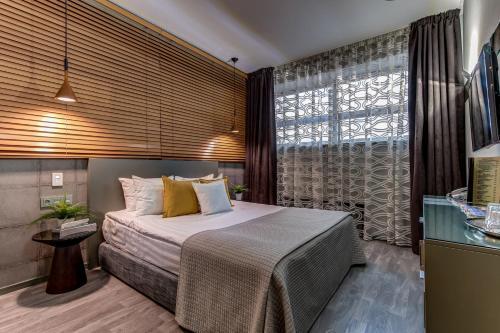 Кровать или кровати в номере Бутик-отель Графтио