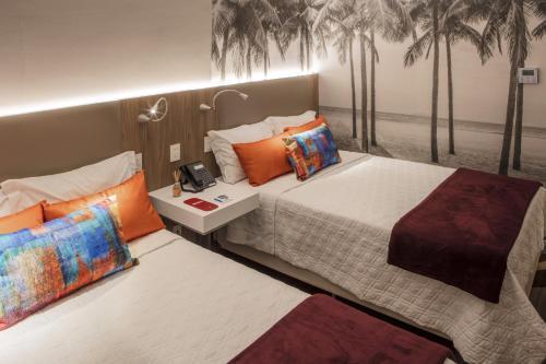 Cama o camas de una habitación en Rio Hotel by Bourbon Ciudad Del Este