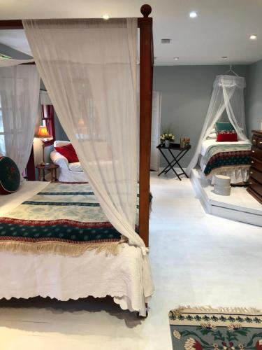 A bed or beds in a room at Barnabrow Country House