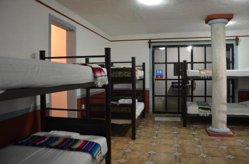 A bunk bed or bunk beds in a room at Hostel Ka Beh