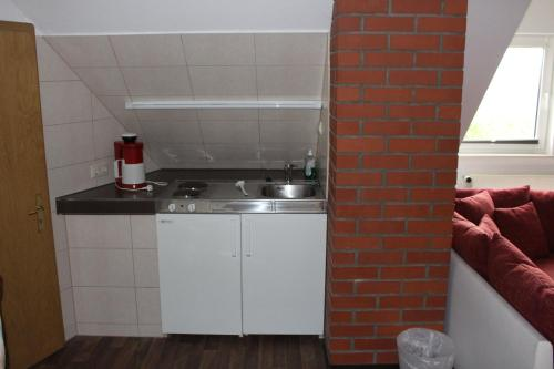 A kitchen or kitchenette at Pension Dräger
