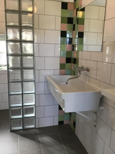 Ein Badezimmer in der Unterkunft Het Bijhuisje