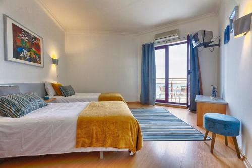 A bed or beds in a room at Beachtour Lux Sunset