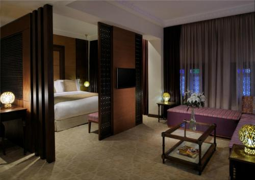 A bed or beds in a room at Souq Waqif Boutique Hotels - Tivoli