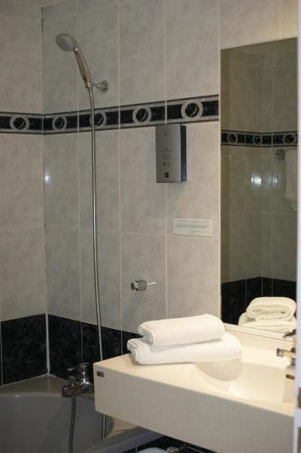 Salle de bains dans l'établissement Hotel Blanc