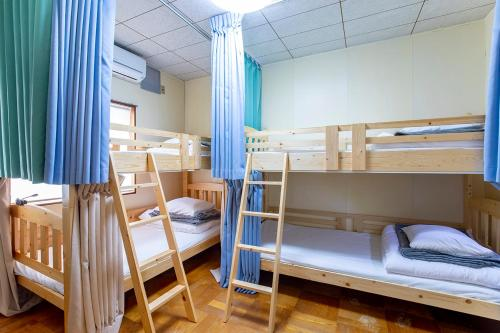 A bunk bed or bunk beds in a room at Guesthouse Nagonde