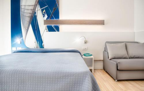Letto o letti in una camera di Hotel Antoniana