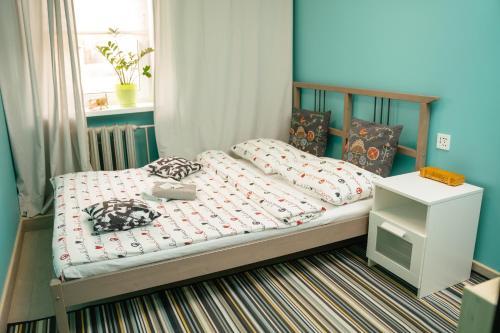 Кровать или кровати в номере First Hostel