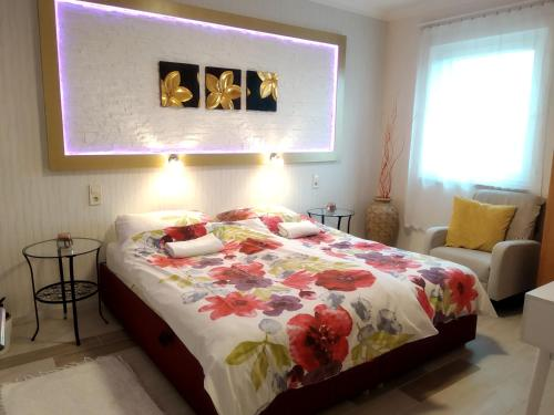 A bed or beds in a room at Family Apartman