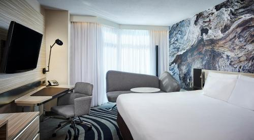 A bed or beds in a room at Novotel Toronto North York
