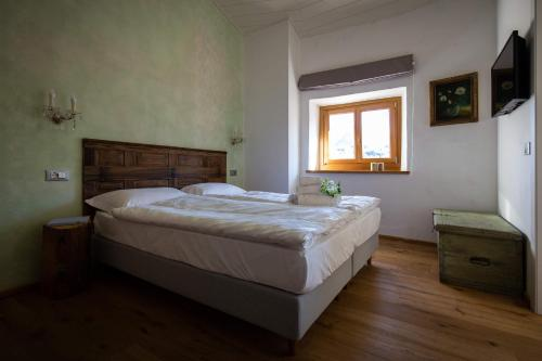 A bed or beds in a room at Torrione Trento