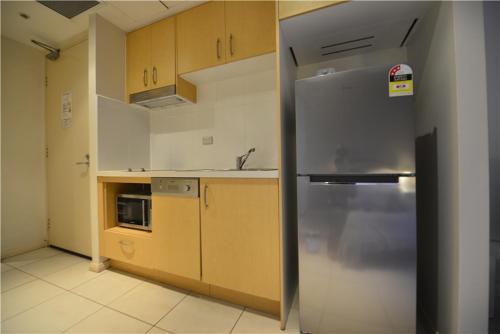 A kitchen or kitchenette at Alora Studio in Sydney Central - Darling Harbour