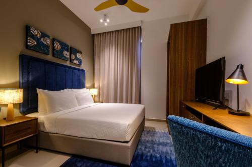 A bed or beds in a room at Tanjung Point Residences