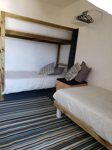A bed or beds in a room at Bunkhouse Bournemouth