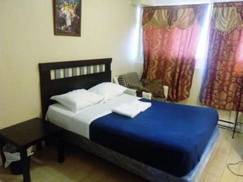 A bed or beds in a room at Alisa Guest Suites