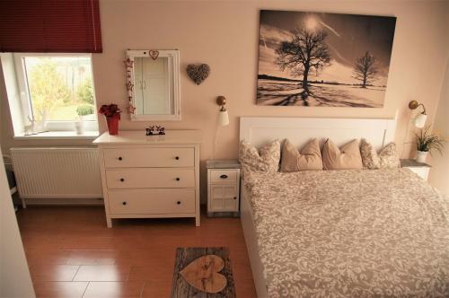 Postel nebo postele na pokoji v ubytování Buxusson Resort