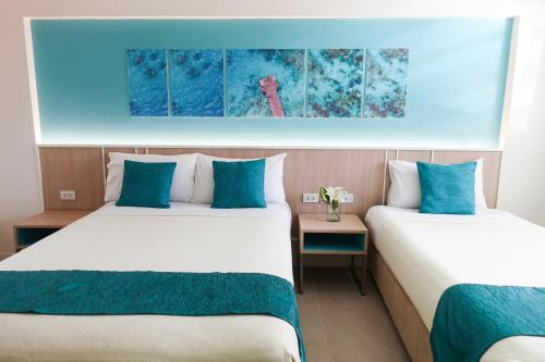 A bed or beds in a room at Patio Pacific Resort