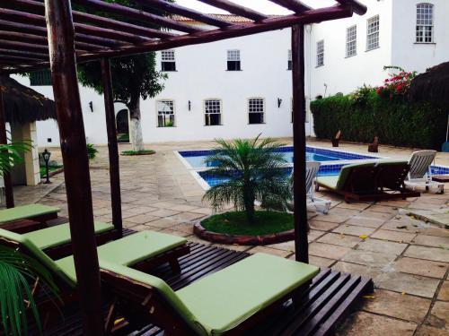 The swimming pool at or near Pousada Convento do Carmo