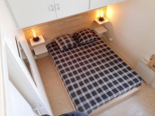 Un ou plusieurs lits dans un hébergement de l'établissement La Naturelle Duplex123