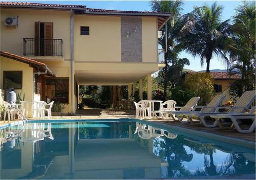 The swimming pool at or close to Pousada da Figueira