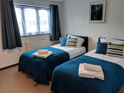 A bed or beds in a room at Princes Lodge