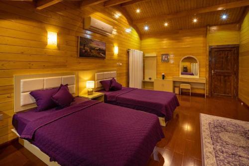 Giường trong phòng chung tại Welf Resort