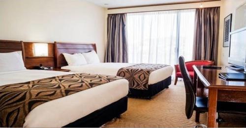 Crown Hotelにあるベッド