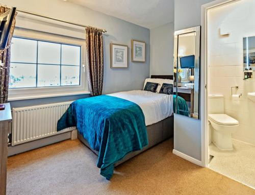 A bed or beds in a room at The Pytchley Inn
